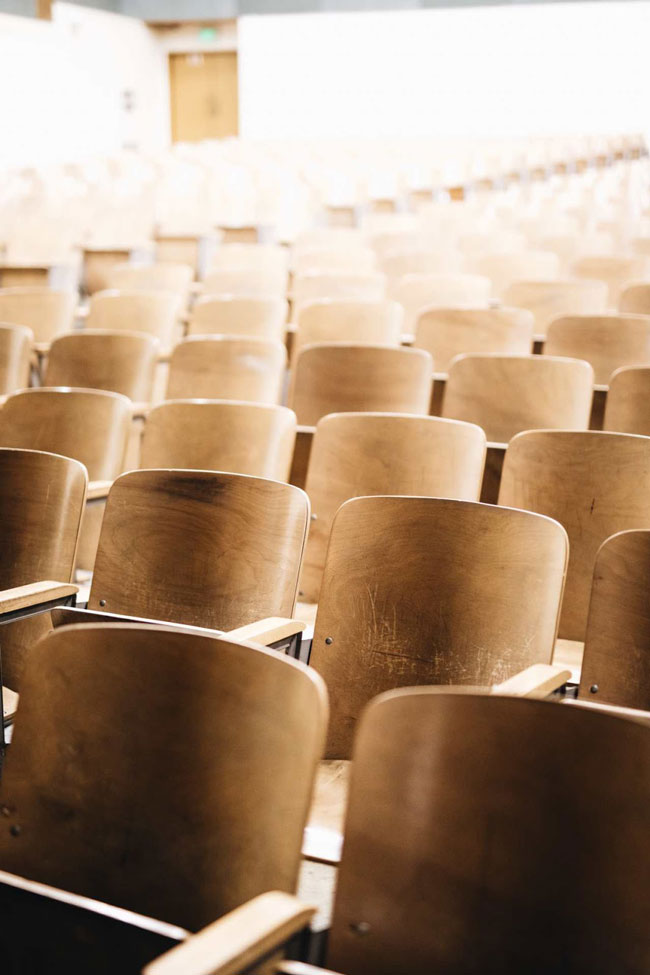 Rows of empty wooden chairs