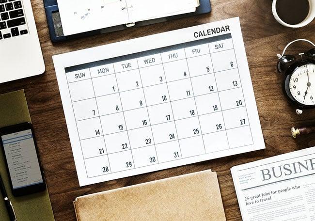 a blank calendar on a desk