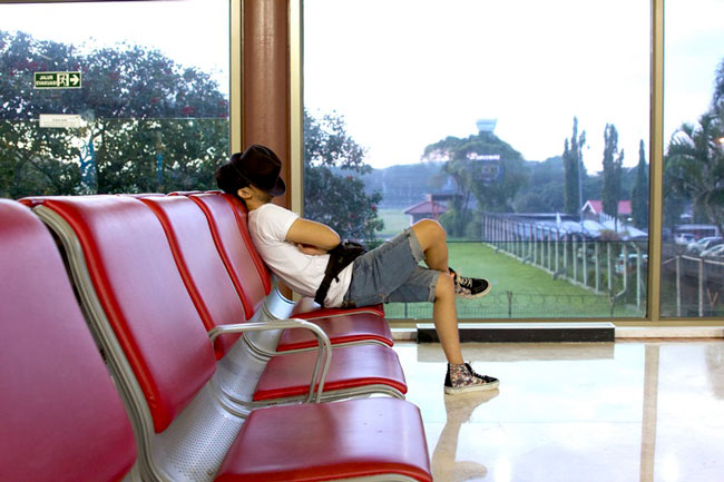 man sits in an empty waiting room