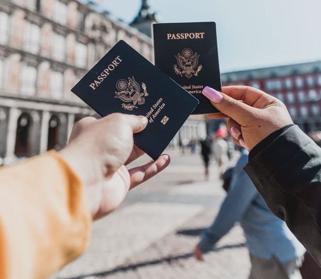 people hold passports while traveling