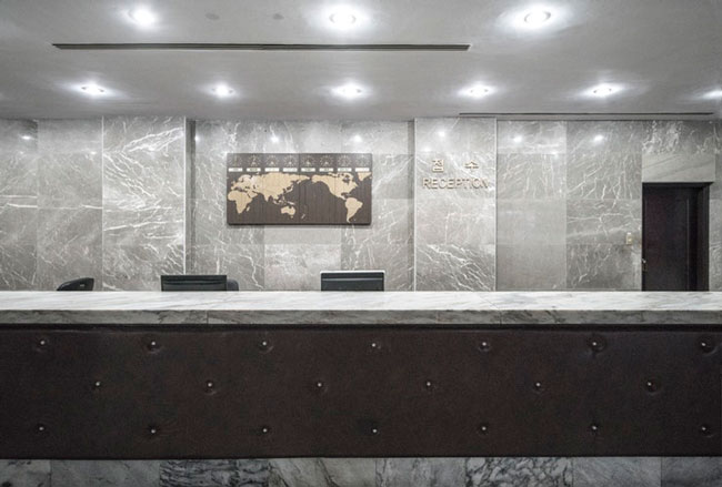 a reception desk stands empty