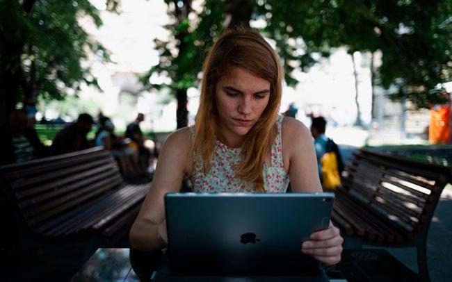 women visits a website on her laptop