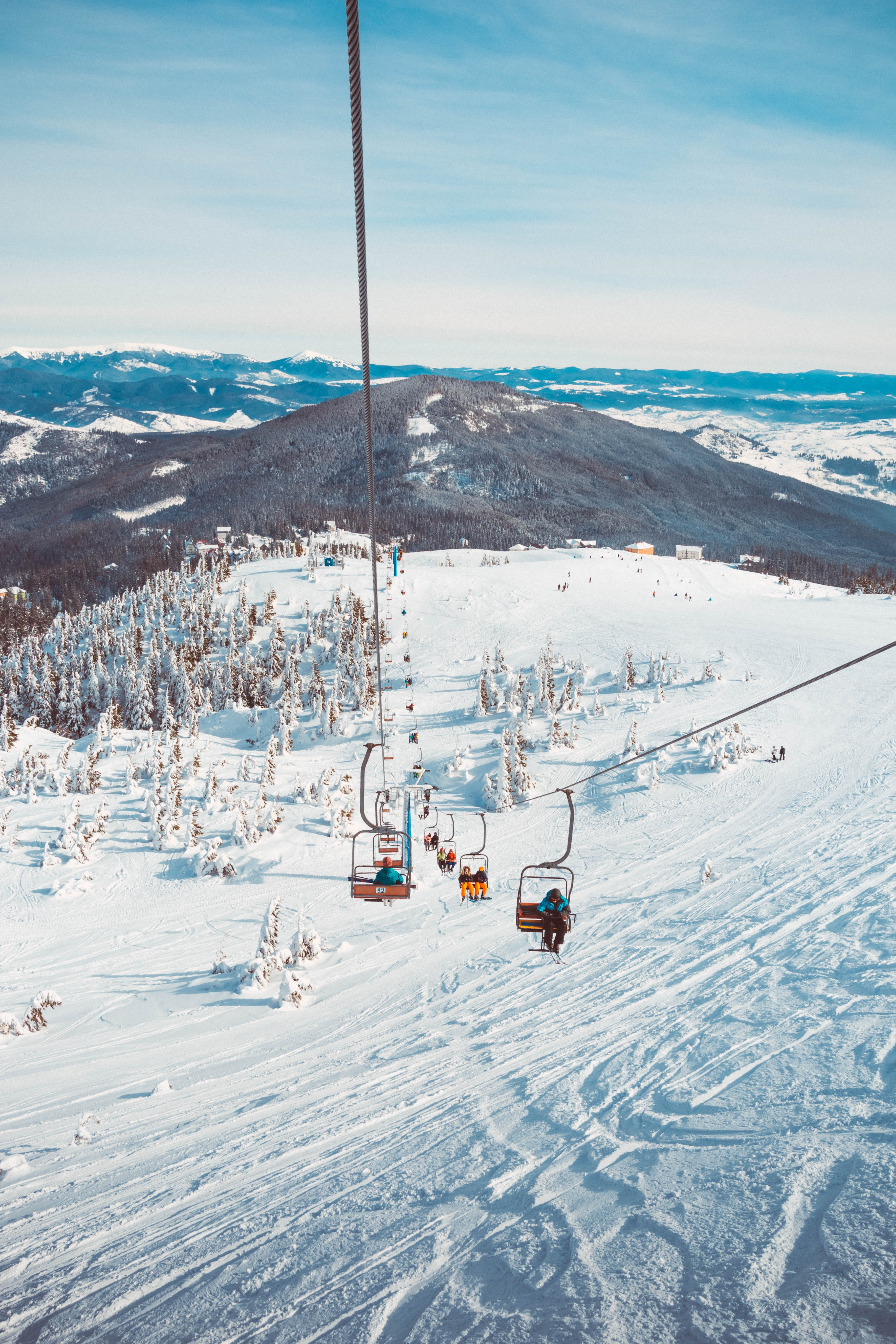 Ski lift going up a snowy mountain