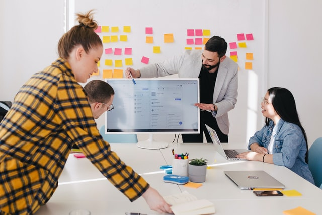 Brainstorming office meeting with business employees