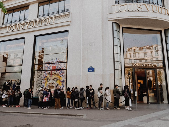 Customer line up outside Louis Vuitton store